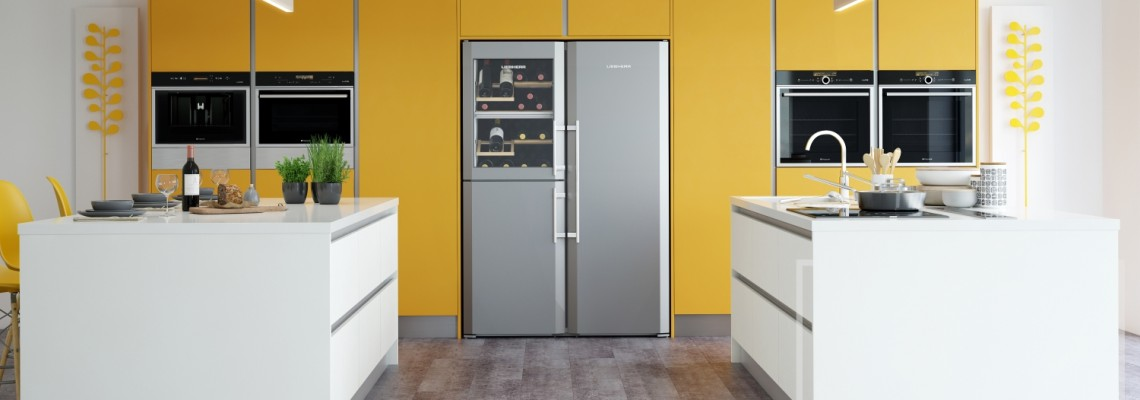 Image of kitchen with modern in-built appliances with yellow and white accents