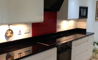Image of kitchen with white gloss cabinetry and red highlights in Eaglesham