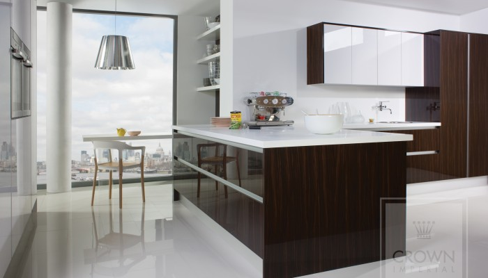 Image of kitchen with white countertops and wood cabinets