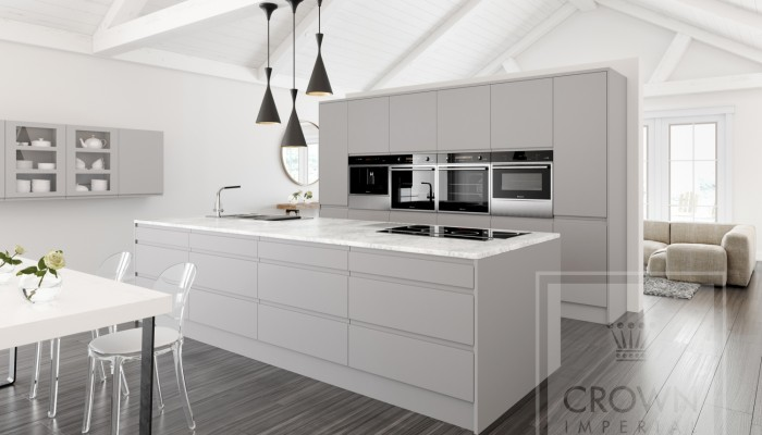 Image of kitchen with grey handleless cabinets, white accents and dark wood floor