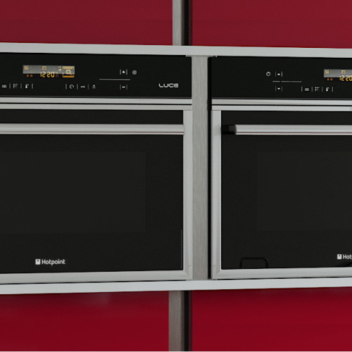Image of built in dual ovens with red cabinetry