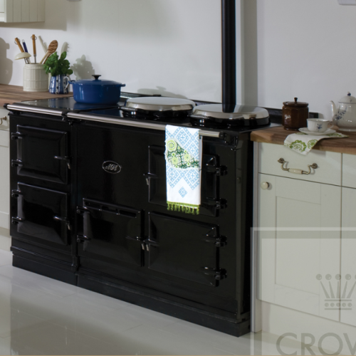 Image of black range cooker with white cabinets and wood countertops