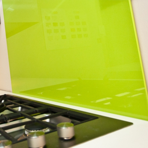 Image of green glass backsplash behind hob