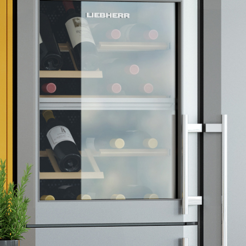 Image of refrigerator with in-built wine rack and bottles of wine