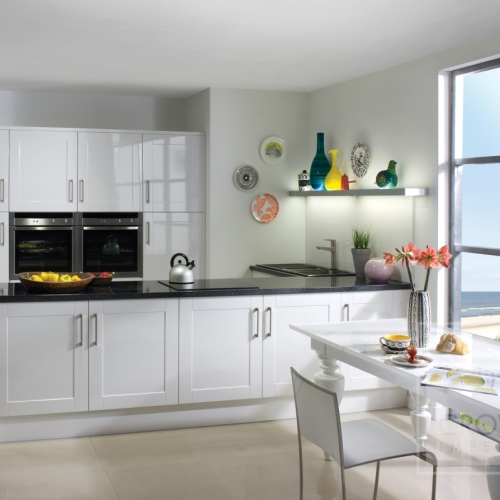Image of kitchen with white shaker gloss kitchen cabinets and black accents