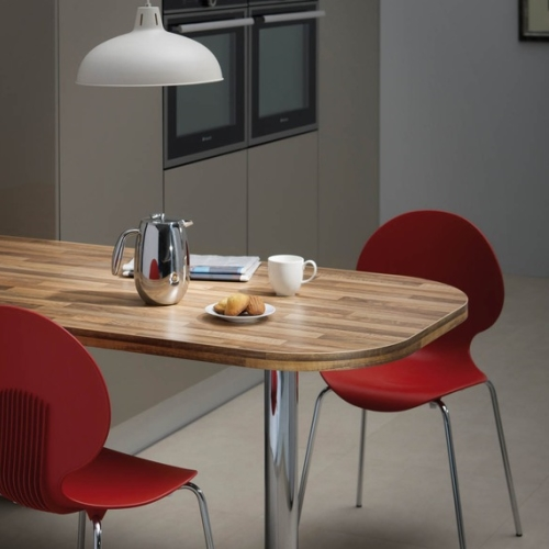 Image of wood laminate kitchen table with red chairs