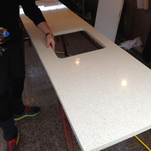 Image of cut quartz countertop before installation