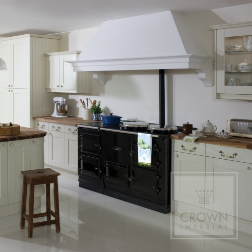 Image of kitchen using traditional wood counter tops and cream cabinets