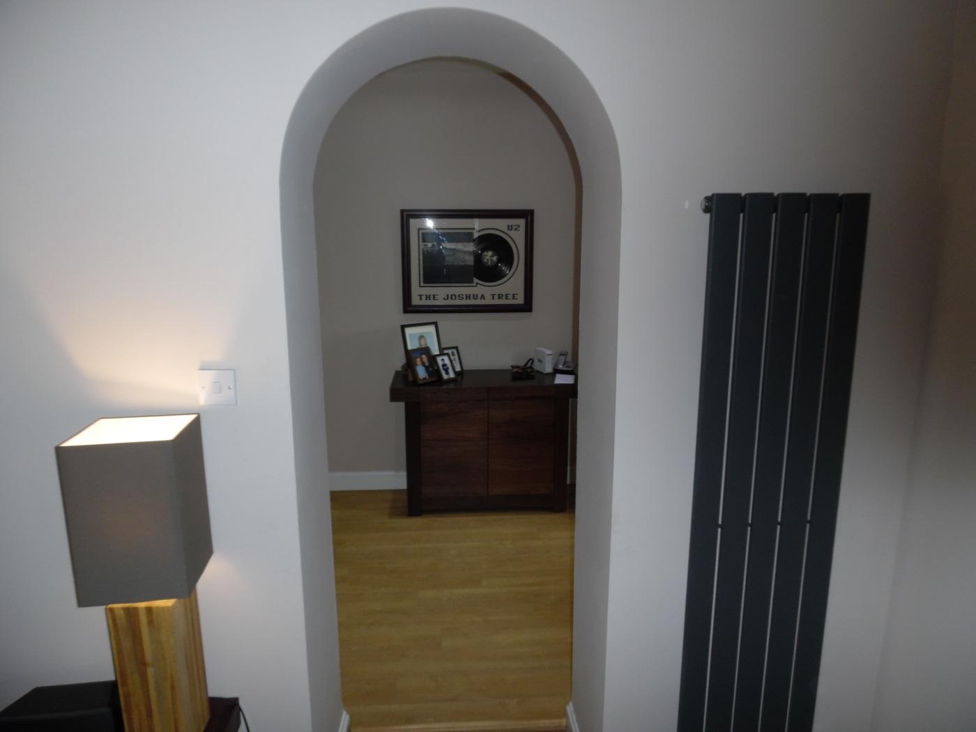 Unique looking entrance with designer radiator