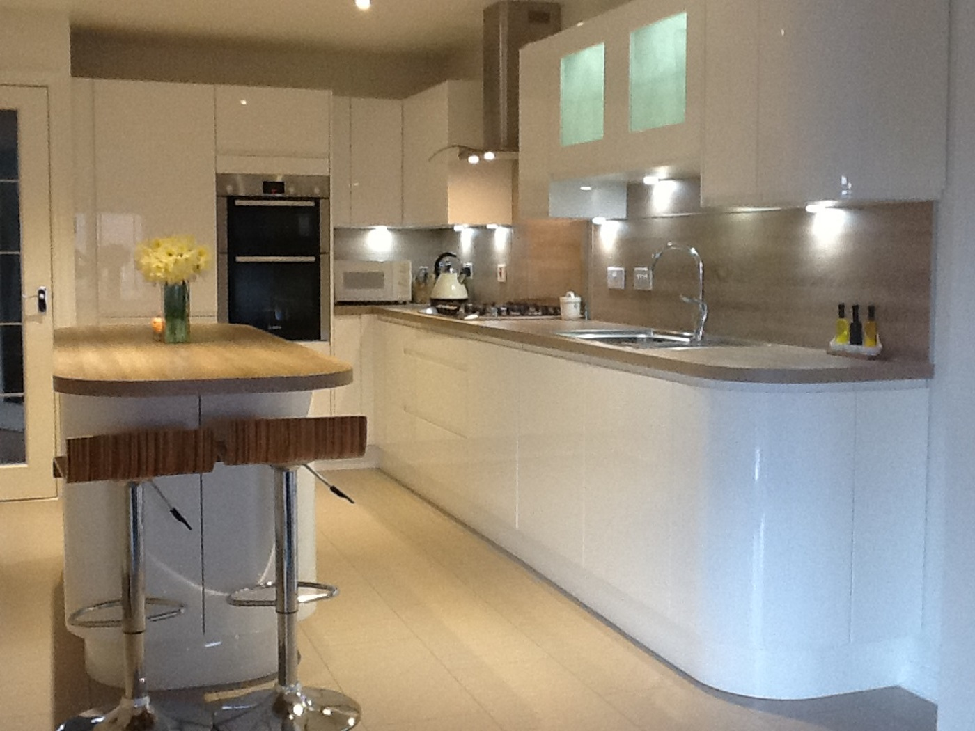 The finished handleless gloss kitchen
