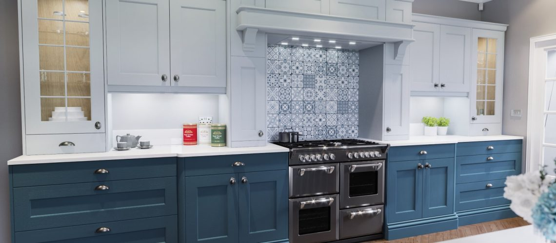 Kitchen in shades of blue with blue and grey cabinets and accent tiling